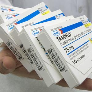 Pharmacist Marty Feltner handles boxes of the antiviral drug Tamiflu at Kohll's Pharmacy in Omaha, Neb. on April 30, 2009 (Nati Harnik/AP Photo)