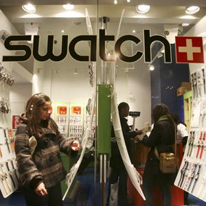 File photo of shoppers in a Swatch store in New York ( Mark Lennihan/AP Photo)