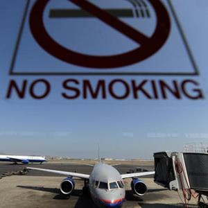 Credit: JEWEL SAMAD/AFP/Getty Images&#xA;Caption: A 'No Smoking' sign is seen as an United Airlines aircraft prepares to take off from the international airport in San Francisco, California