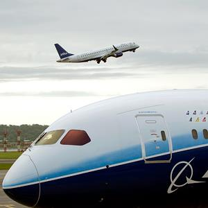 File photo of a Boeing Co. 787 Dreamliner as A JetBlue Airways Corp. airplane takes off in the distance at Reagan National Airport in Washington, D.C. on May 8, 2012 (Andrew Harrer/Bloomberg via Getty Images)