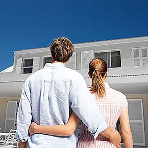Image: Couple with home (Stockbyte/SuperStock)