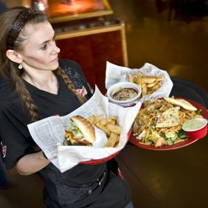 Katy Schneider delivers food to a table at Red Robin on July 6, 2011 in Germantown, MD (Katherine Frey/The Washington Post via Getty Images)