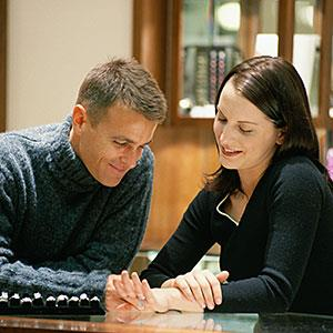 Image: Couple in store shopping for a ring, smiling -- Rob Melnychuk, Digital Vision, Getty Images