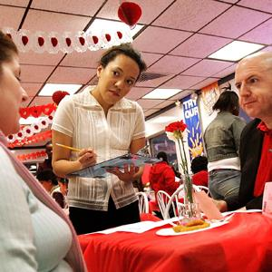 Waitress Christine Rodriguez (C) takes an order from Elizabeth and Thomas Sheffer during Valentine's Day dinner at a White Castle restaurant February 14, 2006 in Des Plaines, Illinois (Tim Boyle/Getty Images)