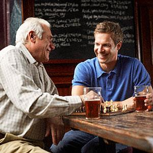 Image: Men drinking beer -Radius Images, Corbis