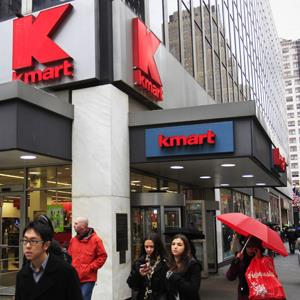 Pedestrians pass a Kmart location in New York ( Frank Franklin II/AP Photo)