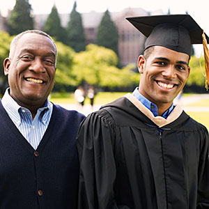 Image: Portrait of young man in graduation gown with father on campus (Thomas Barwick/Digital Vision/Getty Images)