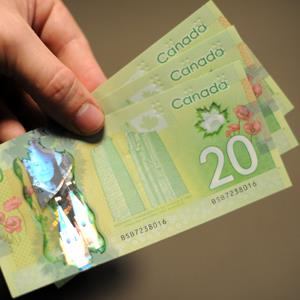 Canadian 20-dollar bills (NICHOLAS KAMM/AFP/Getty Images)