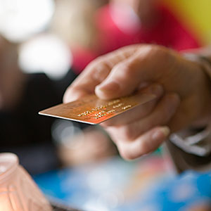 Image: Man paying with credit card --UpperCut Images/UpperCut Images/Getty Images