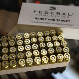 Credit: Scott Olson/Getty Images&#xA;Caption: A box of .45 cal. ammunition is offered for sale