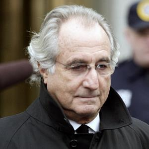 File photo of Bernard Madoff leaving federal court in New York on Jan. 14, 2009 (Gino Domenico/Bloomberg via Getty Images)