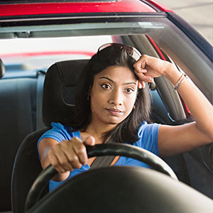 Image: Frustrated woman driving car -- Jose Luis Pelaez Inc/Blend Images/Getty Images