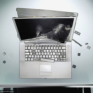 Image: Damaged laptop ( Jason Stang/PHOTOLIBRRAY/Photo Library)