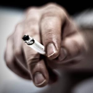 Credit: Vicente Alfonso/Getty Images&#10;Caption: A hand and a cigarette