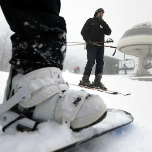 People standing by a lift at Wachusett Mountain Ski Area in Princeton, Mass. on Dec. 27, 2012 (Steven Senne/AP Photo)