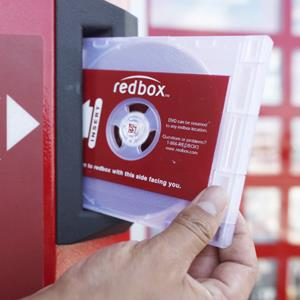 A rental DVD is dispensed from a Redbox in Los Angeles on August 7, 2009 (Damian Dovarganes/AP Photo)