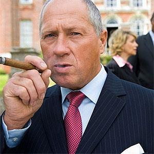 Businessman with cigar --Juice Images , SuperStock 