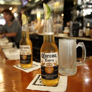 Corona Extra beers, sporting lime wedges, on the bar at Rick's Cafe in Chagrin Falls, Ohio (Amy Sancetta/AP Photo)