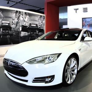 Credit: Bill Pugliano/Getty Images&#xA;Caption: The Tesla Model S Signature is shown during a media preview day at the 2012 North American International Auto Show