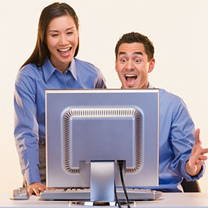 Image: Couple with computer (© Don Mason / Blend Images/Getty Images)