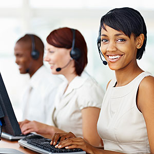Image: Young business woman with her colleagues working in call center -- Daniel Laflor/the Agency Collection/Getty Images
