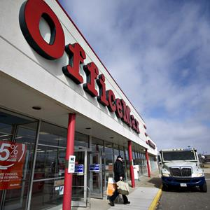 A customer exits an OfficeMax Inc. store in Peoria, Illinois on Feb. 19, 2013 (© Daniel Acker/Bloomberg via Getty Images)