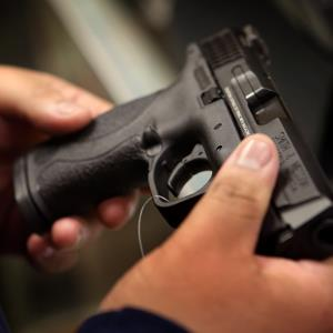 Credit: Scott Olson/Getty ImagesCaption: A customer shops for a pistol at Freddie Bear Sports sporting goods store. December, 2012