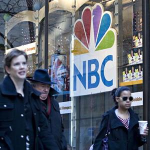 An NBC logo hangs in a window of the NBC Experience store in New York, NY in 2009 (© Daniel Acker/Bloomberg via Getty Images)