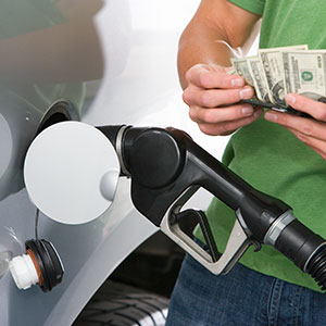 Image: Buying gas (&#169; moodboard/Corbis/Corbis)