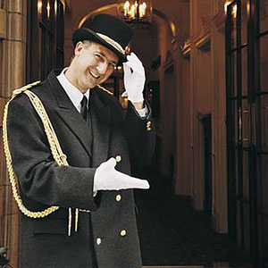 Image: Hotel doorman (© Ocean/Corbis)