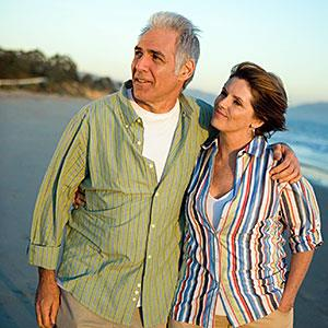 Image: Mature couple hugging on the beach -- Jerry Marks Productions/UpperCut Images/Getty Images