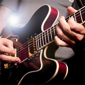 Man playing electric guitar - Simon Webb &amp; Duncan Nicholls, OJO Images, Getty Images