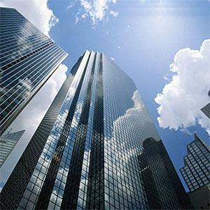 Office buildings reflecting clouds, low angle view -- Skip Nall, Digital Vision, Getty Images