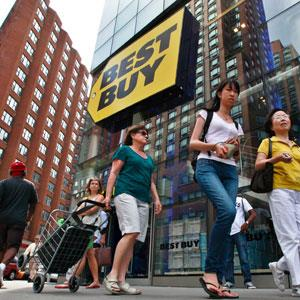 Caption: People walk past a Best Buy store in New York in August 2012