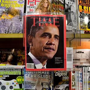File photo of Time Magazine on a New York City newsstand (© Mark Lennihan/AP)