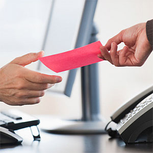 Business hand receiving a pink slip -- Tom Grill, Photographer