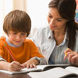 Mother helping son with homework © KidStock, Blend Images, Getty Images