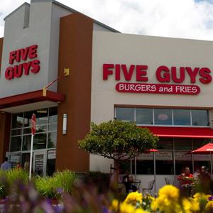 Credit: David Paul Morris/Bloomberg via Getty Images&lt;br /&gt;&lt;br /&gt;&lt;br /&gt;<br /> Caption: A Five Guys Inc. restaurant stands in Dublin, California