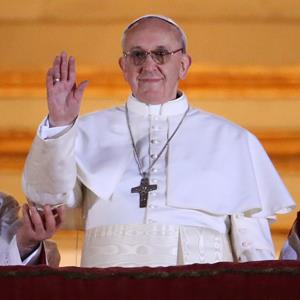 Newly elected Pope Francis I waves from St Peter's Basilica on March 13, 2013 in Vatican City, Vatican (&#169; Peter Macdiarmid/Getty Images)
