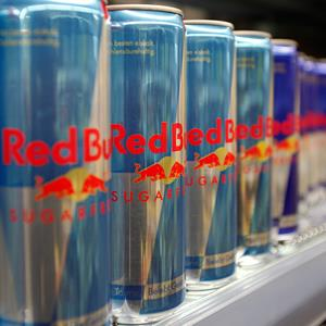 Red Bull drink cans are seen in a supermarket. Credit: © Leonhard Foeger/Reuters