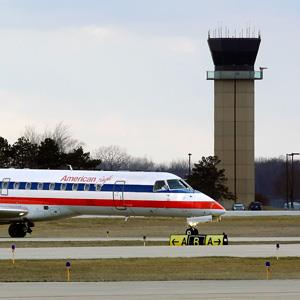 An American Eagle jet taxis to a gate past the control tower after landing at the Abraham Lincoln Capital Airport in Springfield, Ill. on March 12, 2013 (© Seth Perlman/AP)