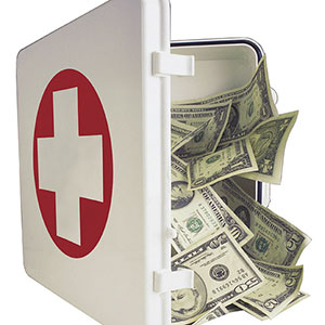 Image: Insurance Money (© Comstock Images/Jupiterimages)