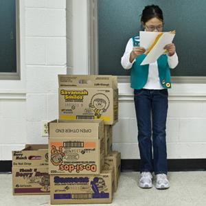 Girl Scout Min Hunt-Neu, 11, looks over her cookie list in Silver Spring, MD, on February 22, 2012 ( Katherine Frey/The Washington Post via Getty Images)