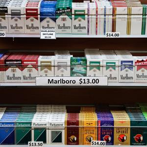 Cigarette packs are displayed at a smoke shop in New York, N.Y., on Monday (Mark Lennihan/AP)