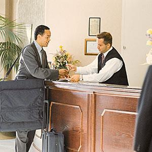 Image: Man at concierge - Comstock, Getty Images
