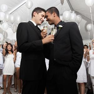 Gay men toasting one another at their wedding reception ( Hill Street Studios/Blend Images/Getty Images)