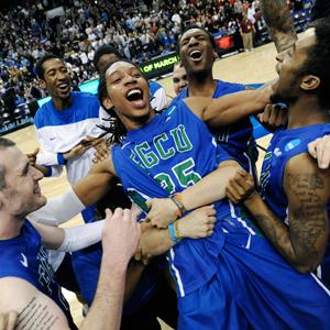 Florida Gulf Coast's Sherwood Brown, center, celebrates with teammates after their 81-71 win over San Diego State in Philadelphia on March 24, 2013 (© Michael Perez/AP)