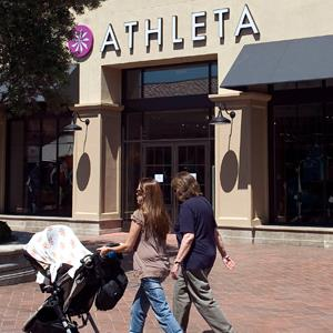 Shoppers walk past an Athleta store in Newport Beach, Calif., on August 30, 2011 (© Paul Bersebach/The Orange County Register/ZUMAPRESS)