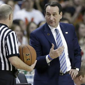 Duke head coach Mike Krzyzewski speaks with an official during an NCAA college basketball game on Feb. 16, 2013 (© Patrick Semansky/AP Photo)