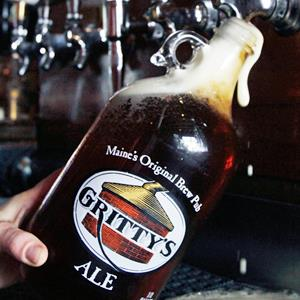 A growler is filled at the bar at Gritty McDuff's in Portland, Maine. Around the country, hundreds of brewpubs, breweries and even grocery stores are cashing in on the growing popularity of growlers. (© Pat Wellenbach/AP)